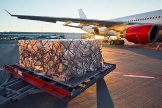 Air cargo shipment being loaded onto an aircraft