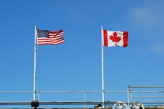 U.S. and Canadian flag flying at border